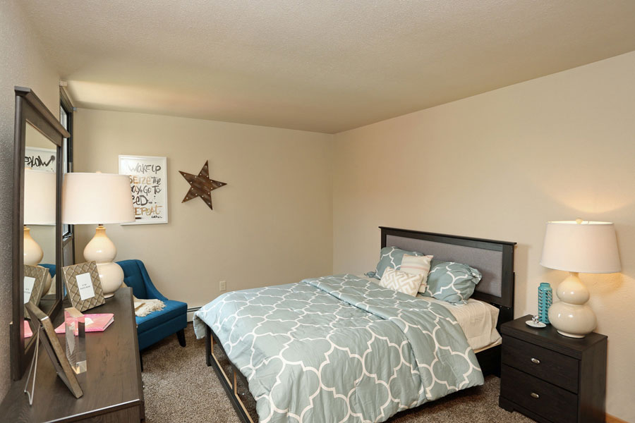 bedroom with bed, dresser and nightstand
